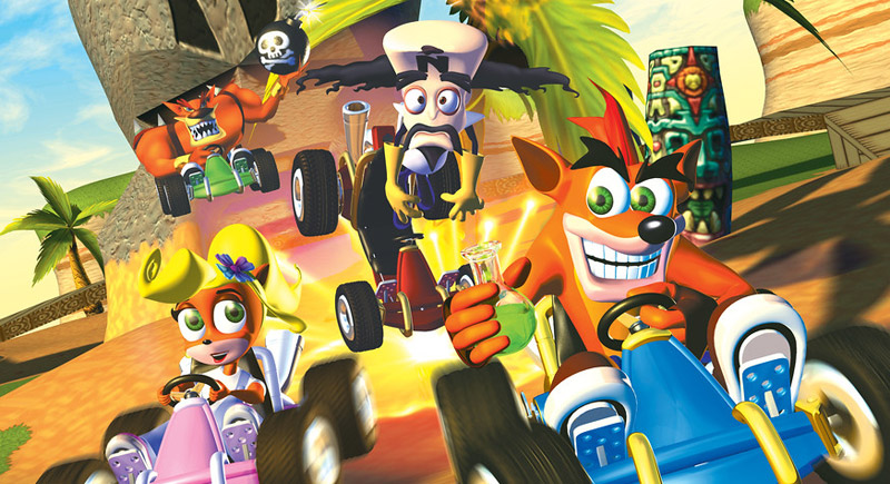 Crash, Coco, Cortex, and Tiny drive karts around the beach. Cortex's kart has exploded, ejecting him in the air. Tiny, who drives behind everyone else, holds a bomb in his hand.