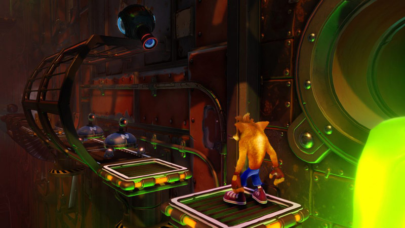 Crash stands on a metal surface in front of a few patrolling robots and an acid-spewing pipe.