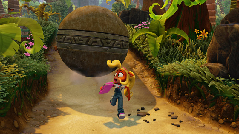 Coco runs from a giant rolling boulder in the middle of the jungle.