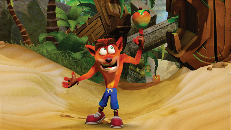 Crash stands on the beach while spinning a Wumpa fruit on the tip of his finger.