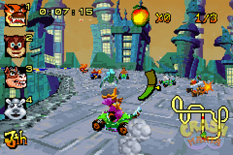 Spyro the Dragon drives a kart around a futuristic city covered in metal surfaces.