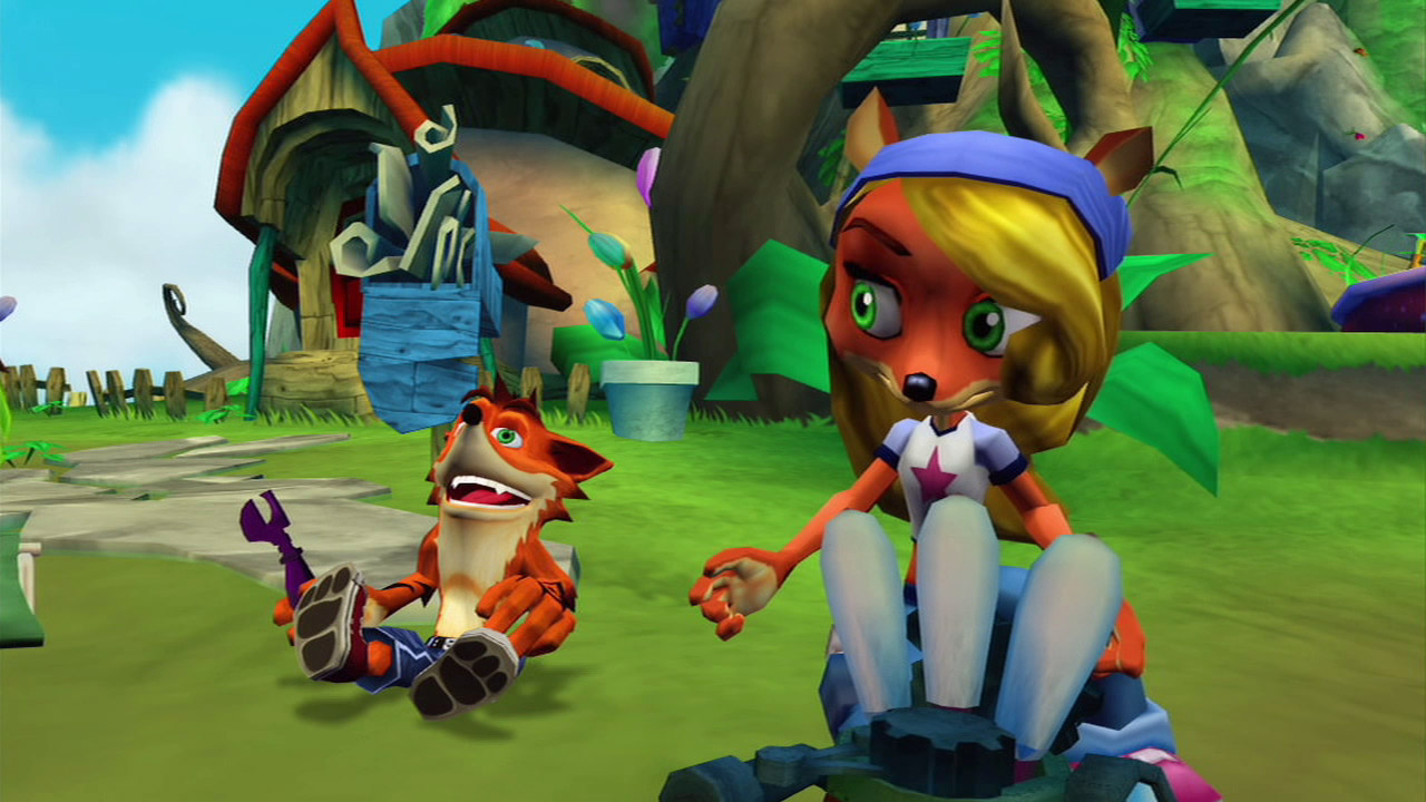 Crash sits on the grass near Coco, who's building a machine in front of their house. Crash is holding a purple tool in his hand.