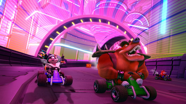 Tiny Tiger, N. Gin, and Crash Bandicoot race in a purple, lightly-brit futuristic metropolis.