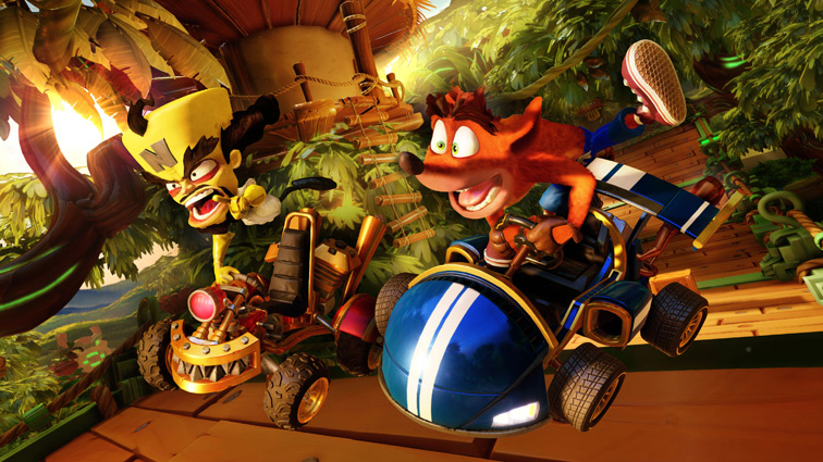 Crash Bandicoot and Neo Cortex drive small karts on top of a wooden bridge in a sunny jungle.