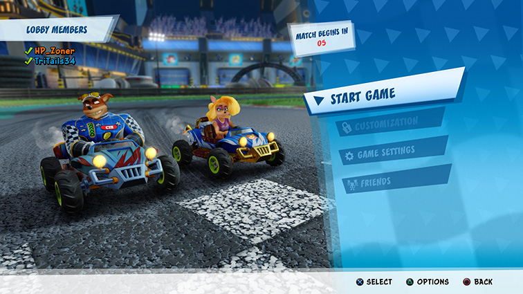 Crunch and Tawna wait in their karts as the race is about to start.
