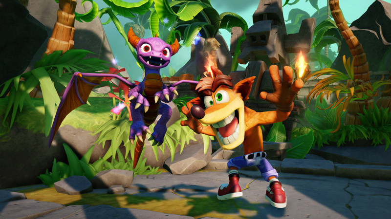 Spyro the Dragon and Crash pose happily in front of the jungle.